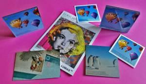 Le magazine Lumas encerclé par des tirages de WhiteWall sur tissus, alu ou plexiglas.