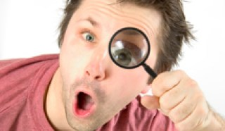man looking though magnifying glass | Xcellence Inspection Services | Blind Inspector Chicago