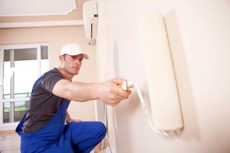 a man roller painting the wall - Xcellence Inspection Services
