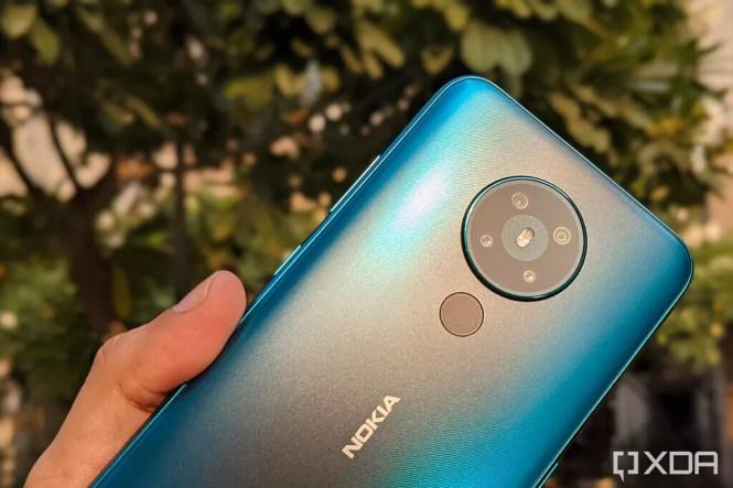 Nokia 5.3 in cyan color under sun