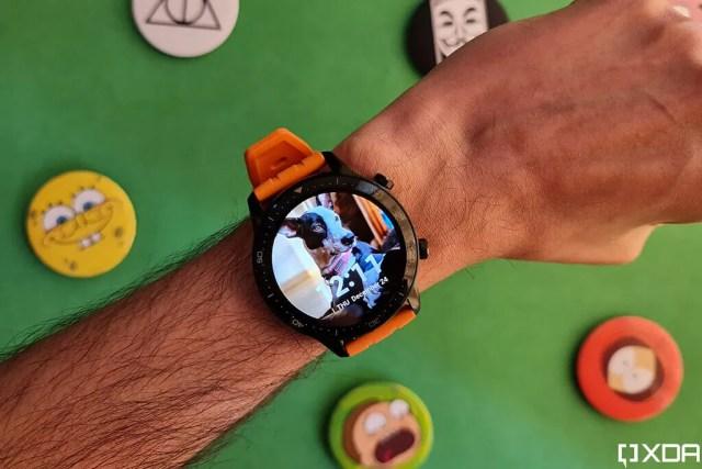 Realme Watch S Pro with orange strap on wrist