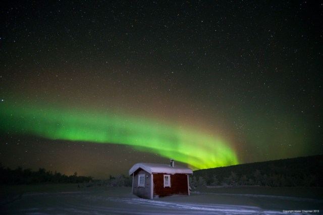 A rainbow of colours from the Northern Lights over the mountain cabins. Taken Jan 2013.
