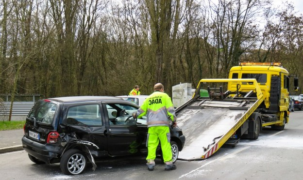 a man towing a car from accident
