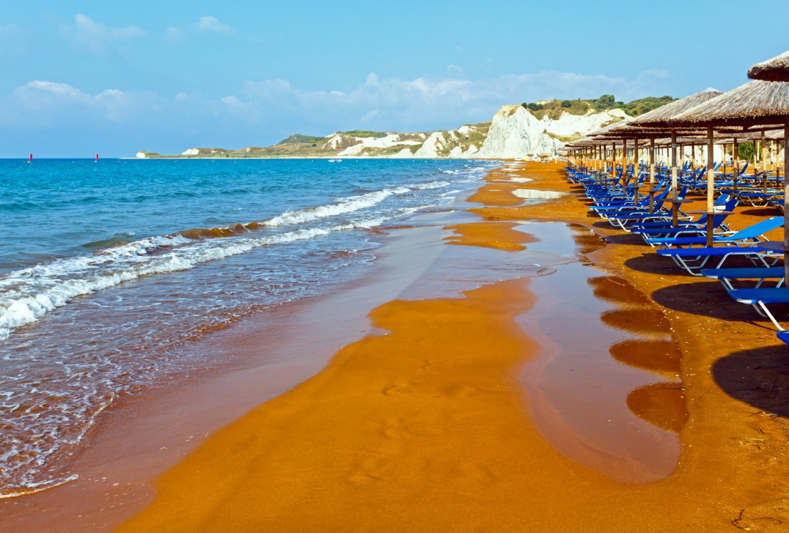 Xi Beach with orange sand. Morning view (Greece, Kefalonia). Ionian Sea.