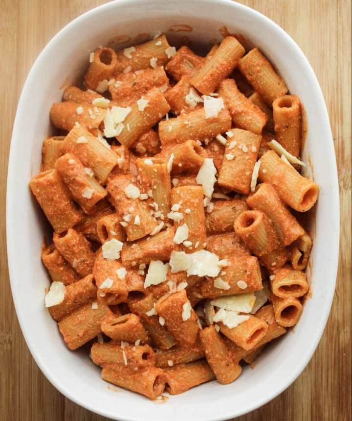 creamy tomato sauce on pasta in a white dish