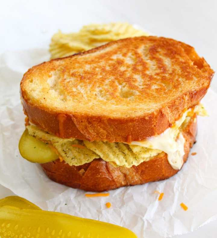 dill pickle grilled cheese on a white background