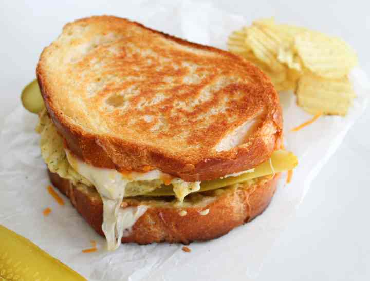a dill pickle grilled cheese on a white background