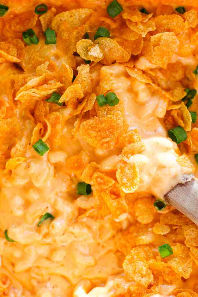creamy chipotle mac and cheese with a cornflake topping and green onions