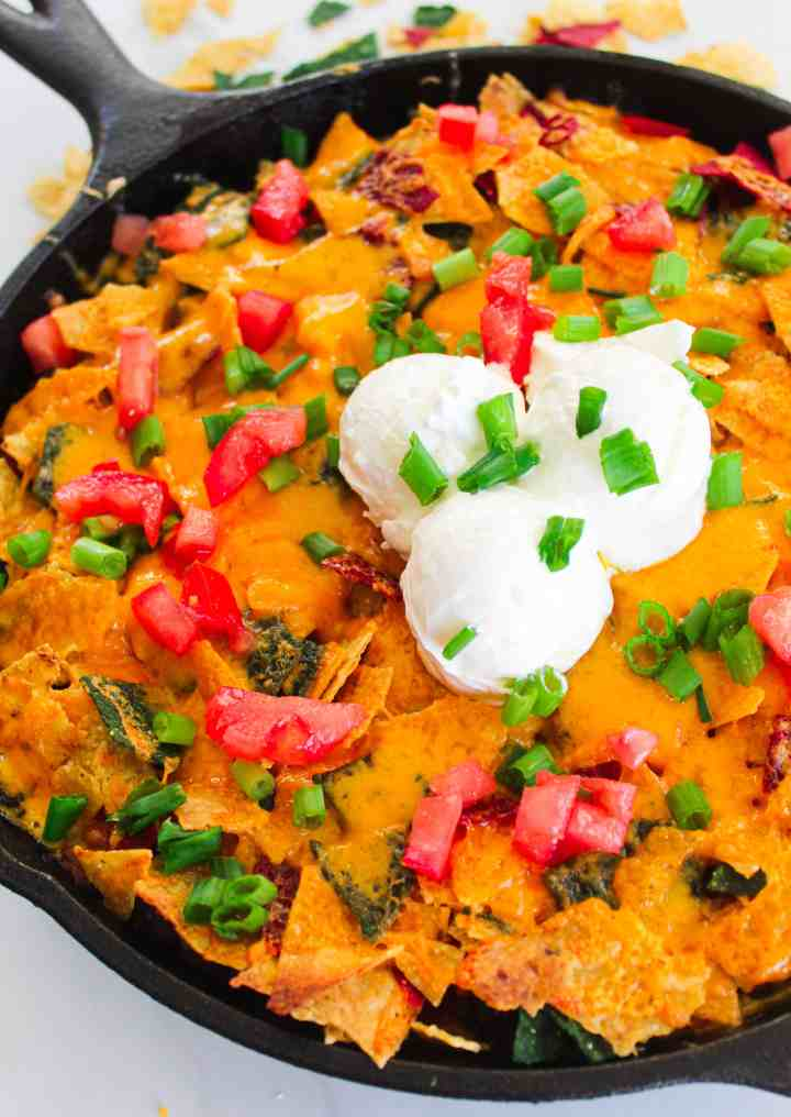 cheesy lentil skillet with multi colored tortilla chips