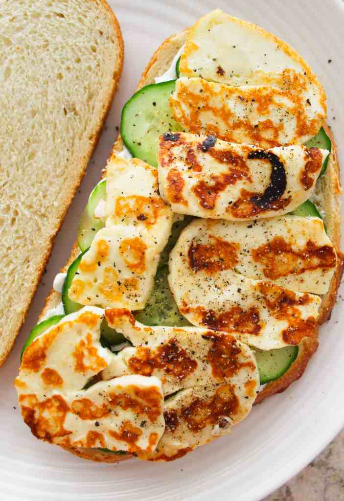 a close up of a summer sandwich with halloumi and cucumber