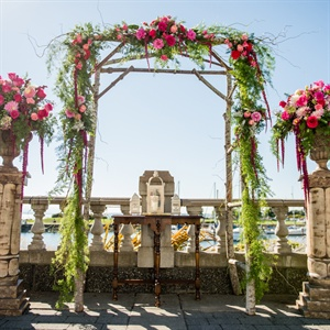 Outdoor Ceremony Arch with Flowers and Ferns