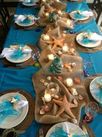 Table setting for DIY mermaid party ideas. Who doesn't love mermaids?! This is genius! So perfect for kids birthday parties! Under the sea and the little mermaid as a party is awesome! So many DIY ideas that are easy and cheap. Which is even better since we done want to break our budgets throwing a mermaid party. I like the food, dessert, decorating, activity ideas! Love it saving it for later!