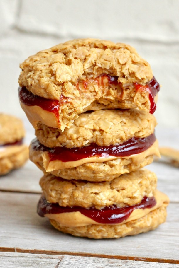 Flourless Peanut Butter & Jelly Cookie Sandwiches | Learn how these creative peanut butter and jelly recipes go beyond the classic sandwich. Choose from Peanut Butter and Jelly Cheesecake or Donuts to PB & J Muffins or Hand Pies. These peanut butter and jelly recipes make lovely desserts, snacks or anytime treats that you and your family will totally love! #xokatierosario #peanutbutterandjelly #pbjdesserts #easypb&jdesserts