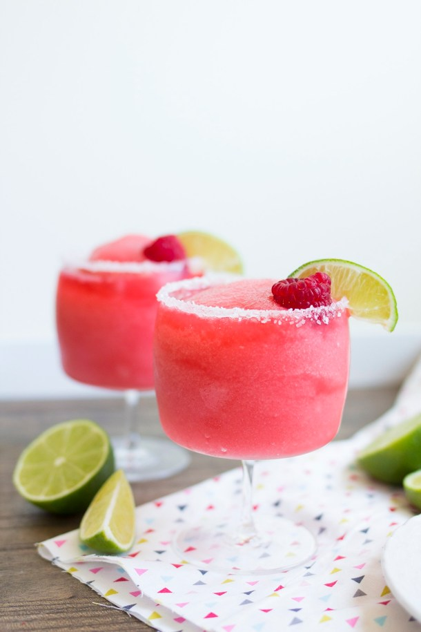 Raspberry Rose Margaritas | These Galentine's Day inspired cocktails are fun twists on classic cocktails that'll make your gal pal day festive! Choose from strawberry Moscow mules or homemade Frosé, cotton candy champagne or a pink senorita. These Galentine's day cocktails will elevate your next girls night! #xokatierosario #galentinesdaydrinks #girlsnightideas #girlsnightcocktails