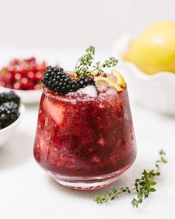 Blackberry Ginger Beer Cocktail | These Galentine's Day inspired cocktails are fun twists on classic cocktails that'll make your gal pal day festive! Choose from strawberry Moscow mules or homemade Frosé, cotton candy champagne or a pink senorita. These Galentine's day cocktails will elevate your next girls night! #xokatierosario #galentinesdaydrinks #girlsnightideas #girlsnightcocktails
