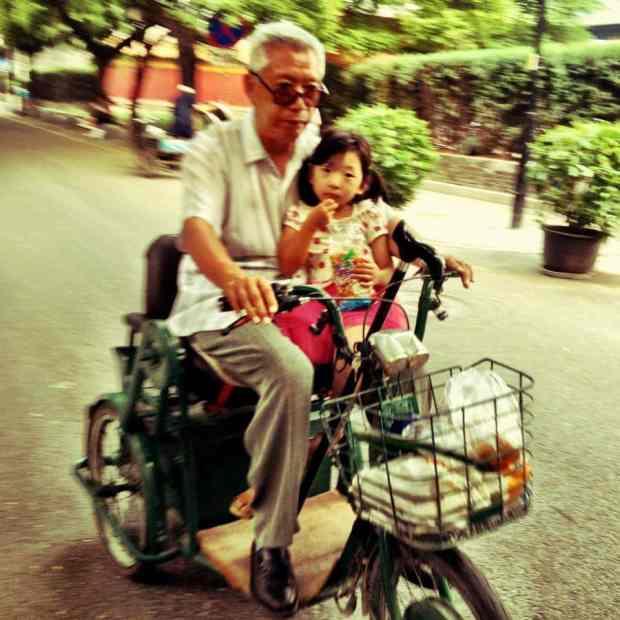Grandfather taking his grandchild from the kindergarten
