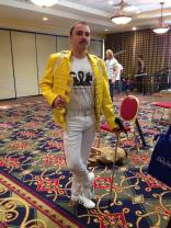 """This costume--from listener Andrew Joyce--is from a con, not Halloween; but we're including it anyway, because it's the hands-down best use of a Probably a Summers Brother t-shirt we have ever seen (and puts a whole new spin on Rob Marsh's legendary """"Wolverine Meets Freddie Mercury"""" Marvel submission)."""