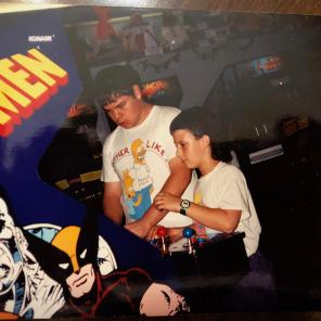 Not only did Miles have a partially-neon Bart Simpson shirt in the early 90s (as did the much older kid next to him), he also had a truly questionable mullet.
