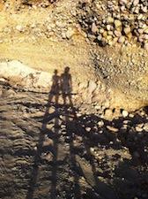 shadow portrait of two women on a rock