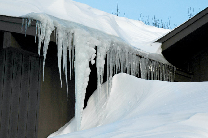 Ice dams build up on roof
