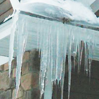 bad ice dam build up on home exterior roof and gutter