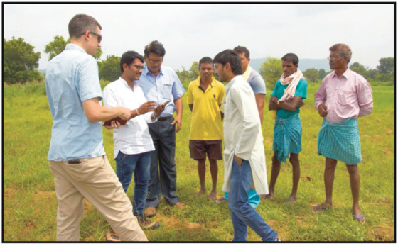 Frank Pichel of Cadasta assists Landesa staff and trained community members in using mobile applications for field data collection in Telangana, India, to help update the government's land records. Credit: David Palomino, Cadasta.