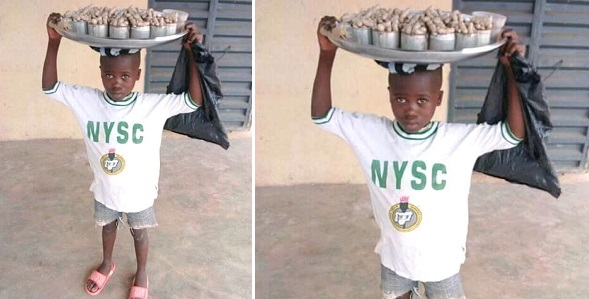 little boy wearing NYSC uniform