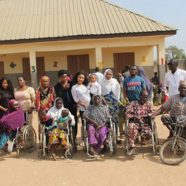 tonto dikeh and crippled2 - Tonto Dikeh All Smiles As She Visits Physically Challenged People In Abuja.