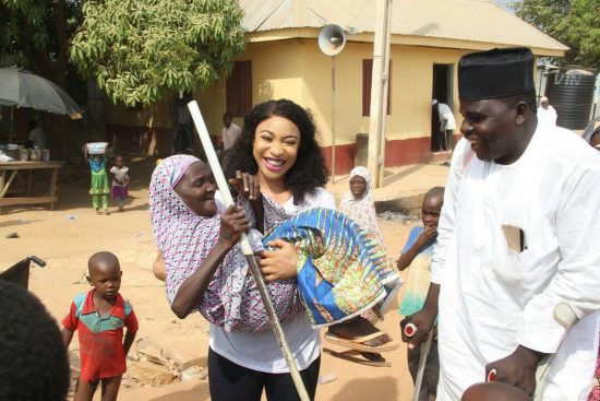 tonto dikeh and crippled3 - Tonto Dikeh All Smiles As She Visits Physically Challenged People In Abuja.