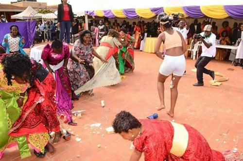 Photos have emerged on social media showing the shocking moments a young woman in the Masaka area of Uganda, was brutally attacked by 'evil ghosts' on her traditional wedding day and she undressed herself to the surprise of guests.
