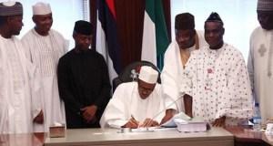 President Buhari signs