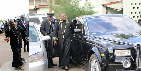 Lagos pastor, Tom Samson, strikes a pose beside his Rolls Royce phantom
