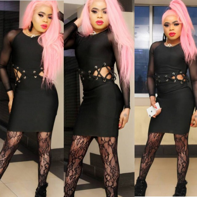 Nigerian male babrie, Bobrisky yesterday, stepped out with his blazing pink hair and a tight, revealing black dress.
