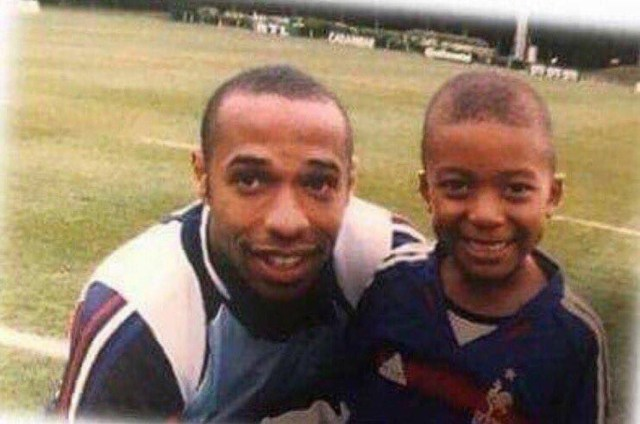 Thierry Henry with a Fan