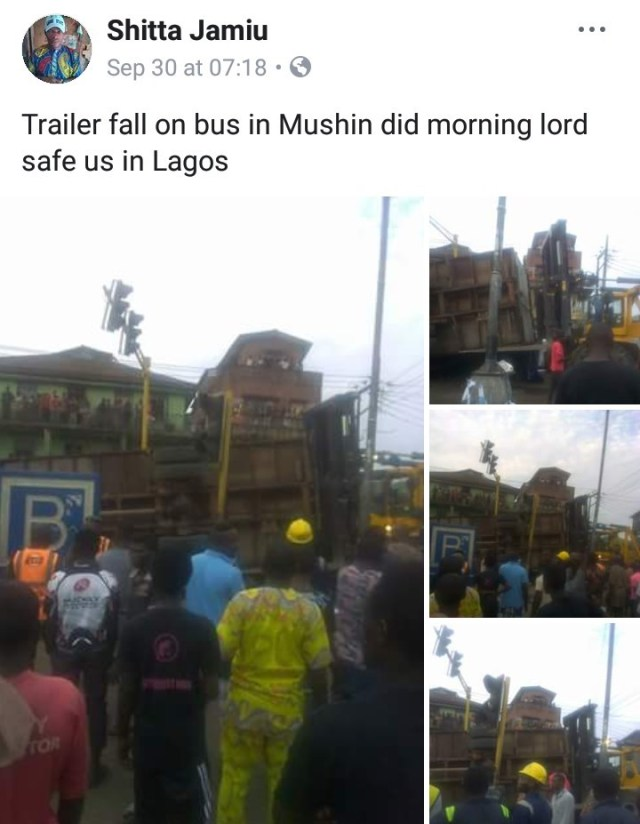 Truck fall on bus1 - PHOTOS: Driver killed as truck conveying tomatoes falls on bus in Lagos