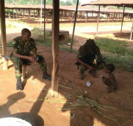 Troops rescues a malnourished child