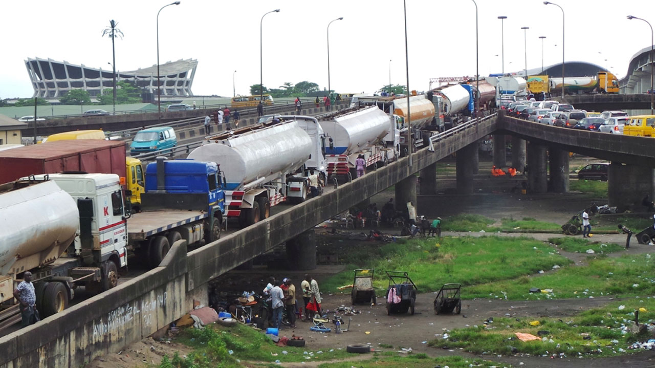 Image result for Lagosians react as illegally parked tankers and containers mysteriously disappear from roads ahead of President Buhari's Saturday visit