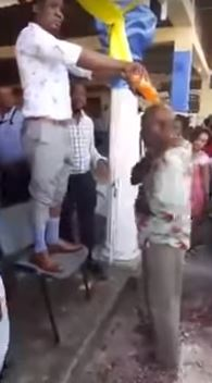 Pastor baptizes church members