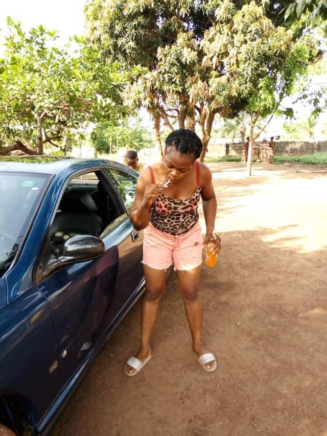 Nigerian Lady Brushes teeth
