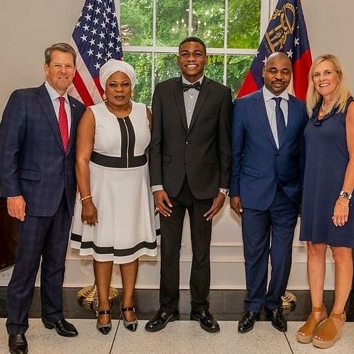 MC Oluomo and family strike a pose with Governor of Georgia, USA (photos)