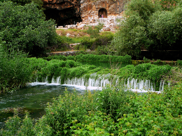 "waters of the Banias Spring (one source of the Jordan River), with Pan's Cave, aka the Gates of Hades, in the background - For Greco-Roman pilgrims to the sanctuary, the large cave, with its seemingly bottomless pool and flowing stream, marked an entrance to the underworld or ""gates of Hades."" The spring no longer flows out of the cave but rises from the ground below."