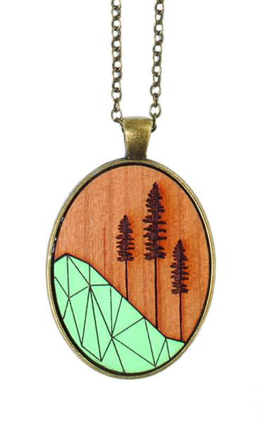 Ugly Bunny geometric Sitka tree laser cut wooden necklace, available at Migration Boutique. $45