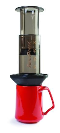 AeroPress coffee maker, available at Cook Culture, and Dansk mug, available at Silk Road. AeroPress: $38; Set of 4 mugs: $38