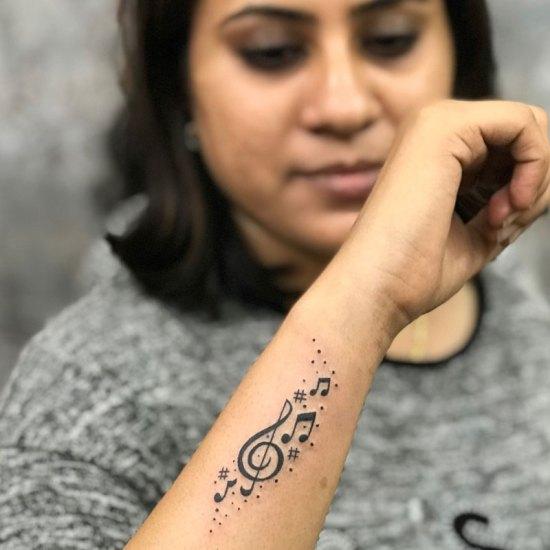 side wrist music tattoo design chennai