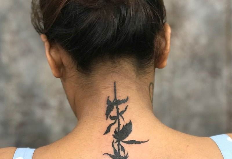 gothic rose tattoo on neck back yantra tattoos