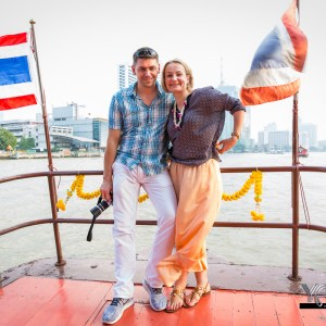 A Smiling couple on a Boat Cruise in Bangkok.