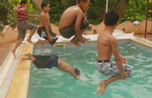 Children jumping in the water pool