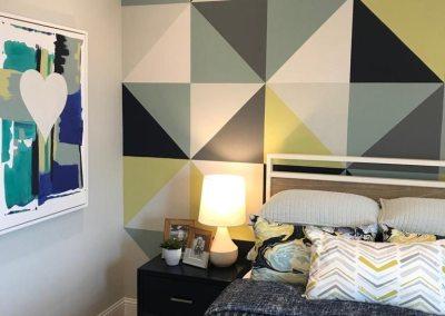 Leuke slaapkamer met groene tinten