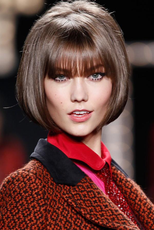 Photo of fashionable haircuts on medium hair with a bang