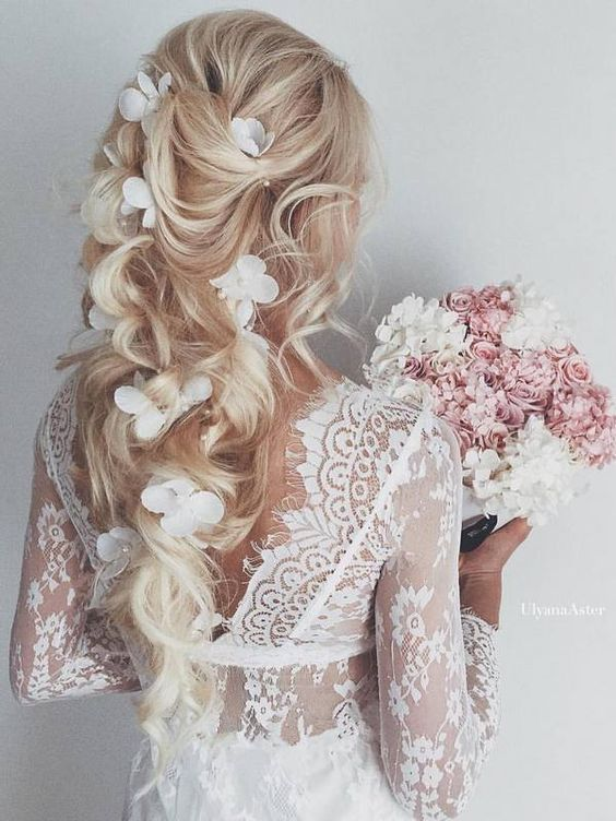 Festive or wedding hairstyle for long hair with curls and flowers
